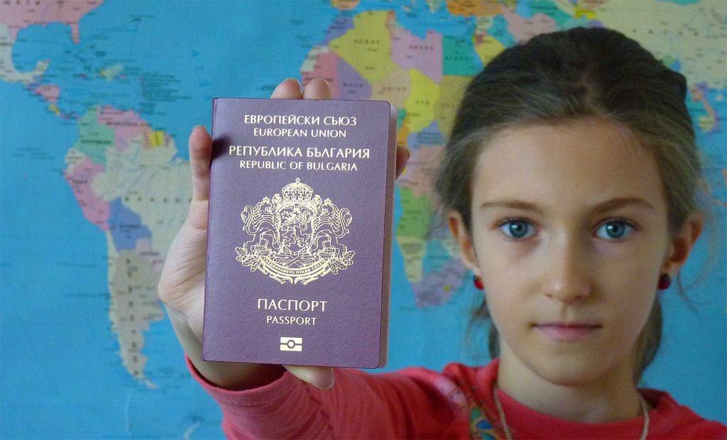 girl holding Bulgarian pasport